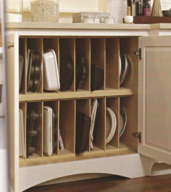 Kitchen -organized pan storage.   We really need something like this.  I like how it's in a cupboard too so the clutter is hidden away #kitchencabinetideas
