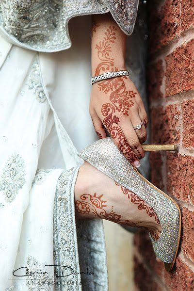 Indian bridal wear in white. With classy shimmer & just enough mehendi