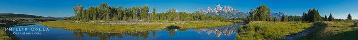 Panorama of the Teton Range reflected in the still waters of Schwabacher Landing, a sidewater of the Snake River. Grand Teton National Park,...