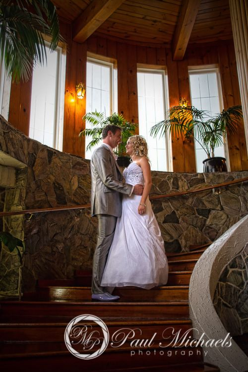 Bride and groom on the stairs at Wallaceville house.