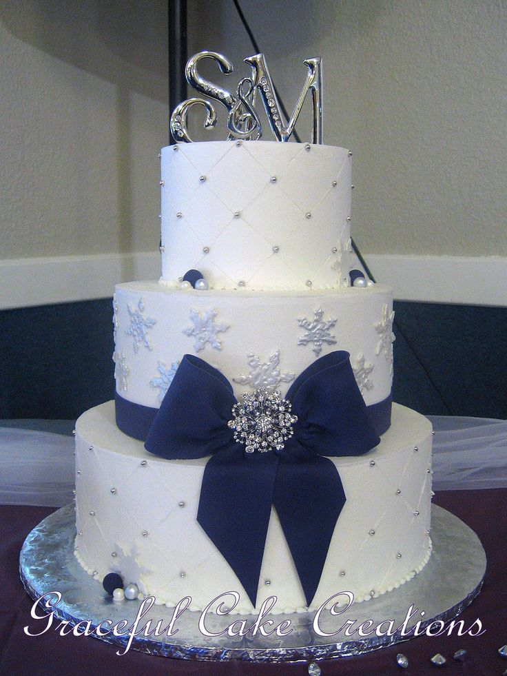 https://flic.kr/p/ChjJJY | Elegant White Butter Cream Winter Wedding Cake with Snowflakes and Purple Ribbon and Bow