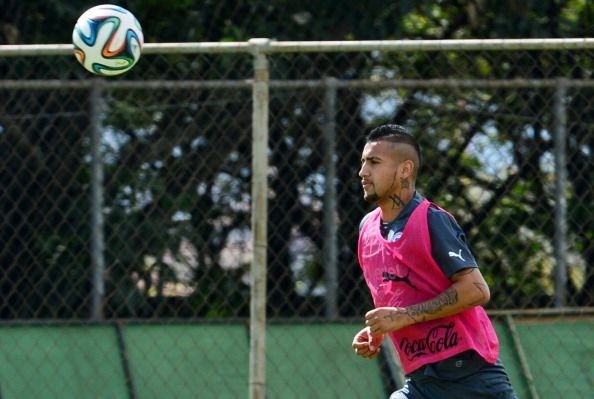 Chile's national football team midfielder Arturo Vidal runs for the ball during a training session at the Toca da Raposa training ground in Belo Horizonte, on June 11, 2014, ahead of the 2014 FIFA World Cup in Brazil