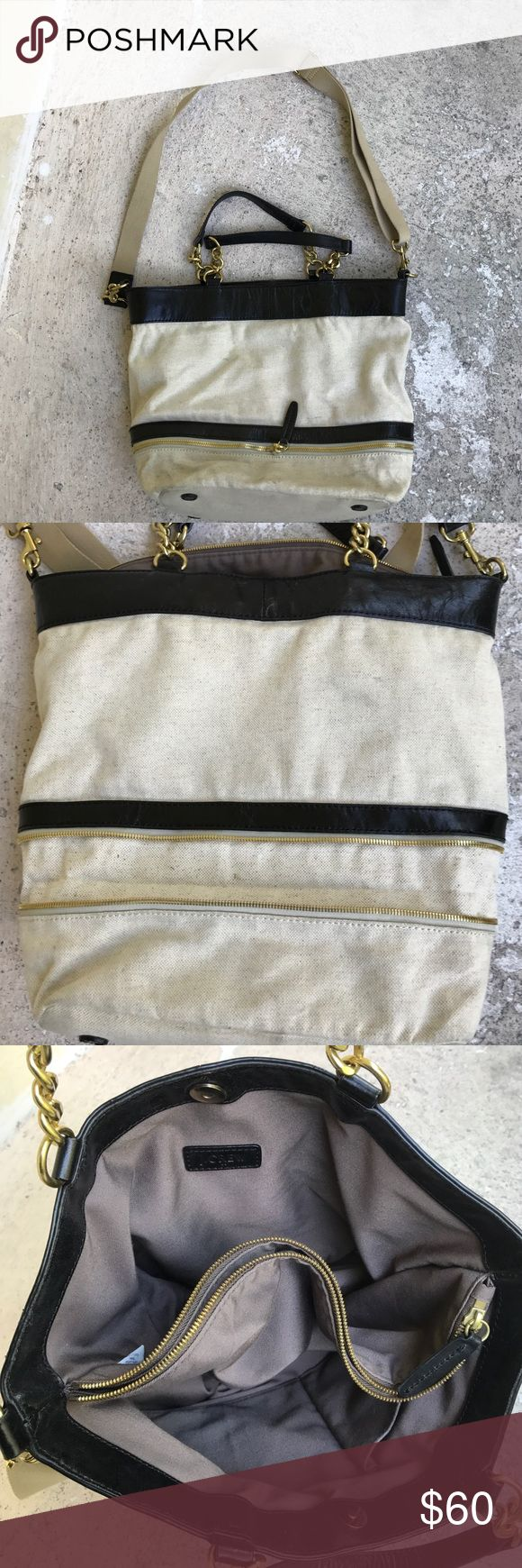 J Crew bag Cream colored canvas with black leather trim bag, Is in very good shape but needs to be thrown in the washing machine to wash. Inside is very clean has two large Side with a zippered divider. Bag is in very good condition J Crew Bags Totes