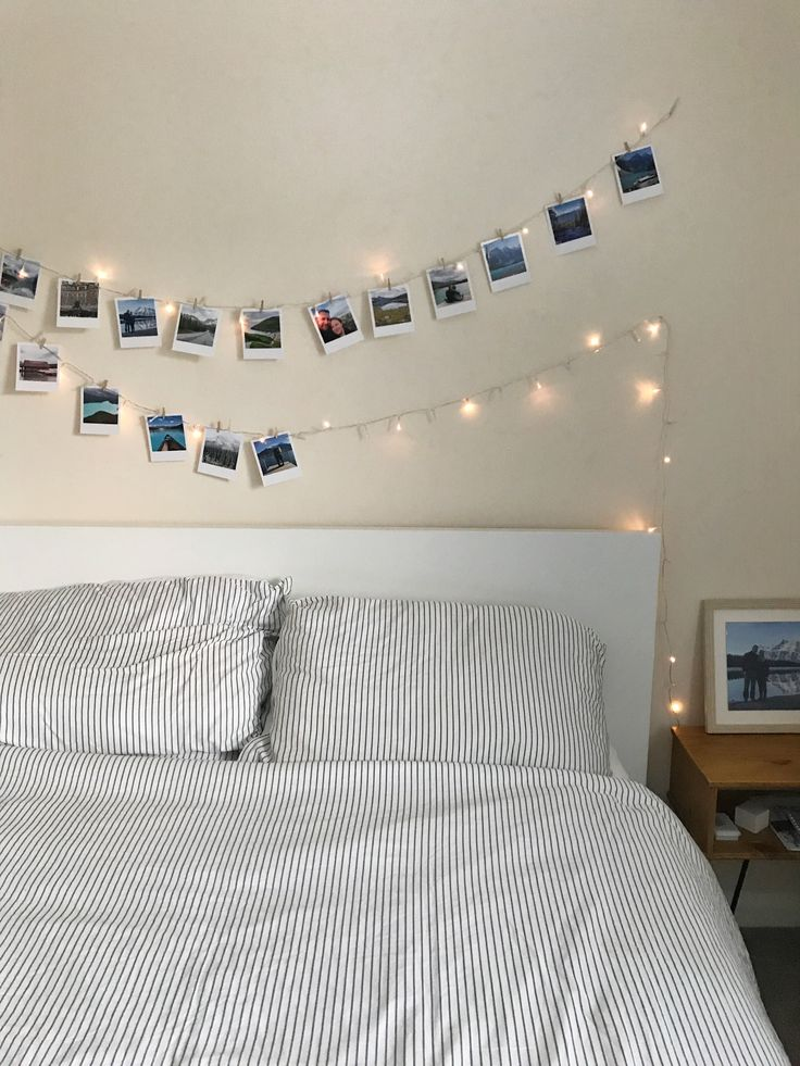 Print out your adventure photos and hang them on fairy lights above your bed; there's no better way to show off your travel photos!