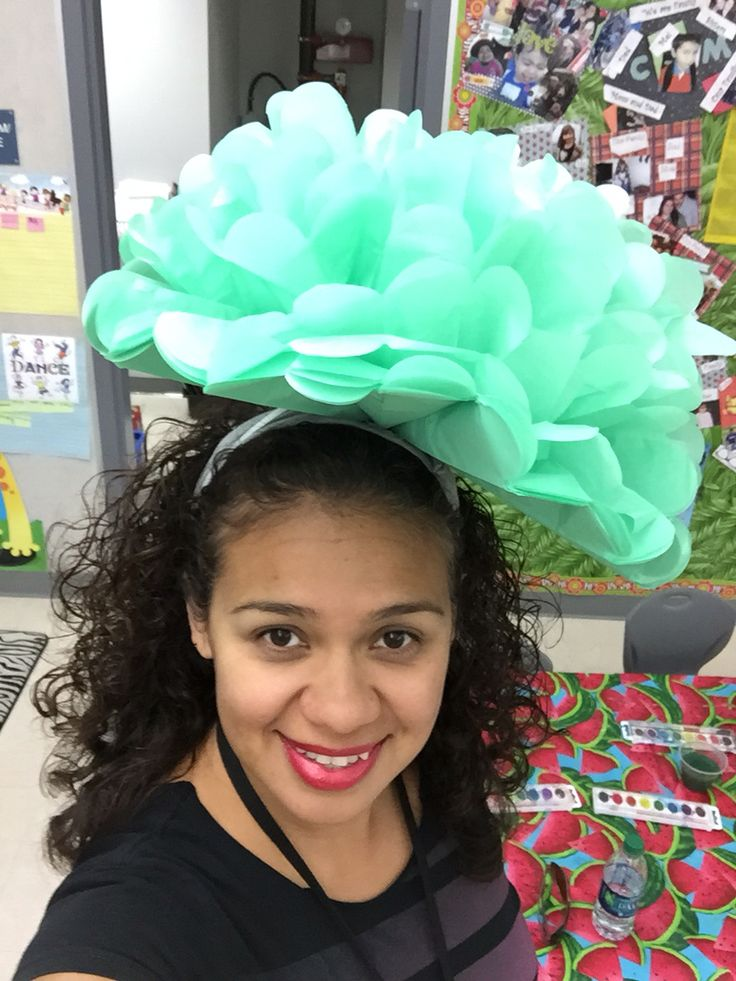 Crazy hat day at school. I bought a pompon from oriental trading. Only opened it half way and super glued it to a headband. Viola! Crazy flower hat!