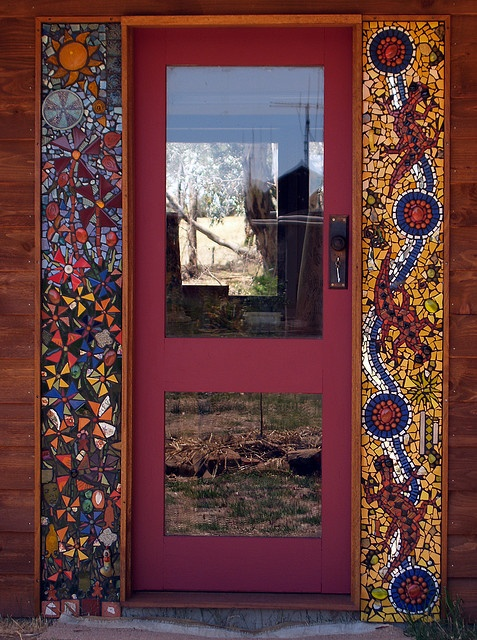 Mosaic Studio Panels-a simple door with pops of color and shape on the sides.