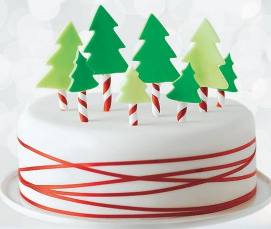 Christmas cake decorated with red and white icing trees