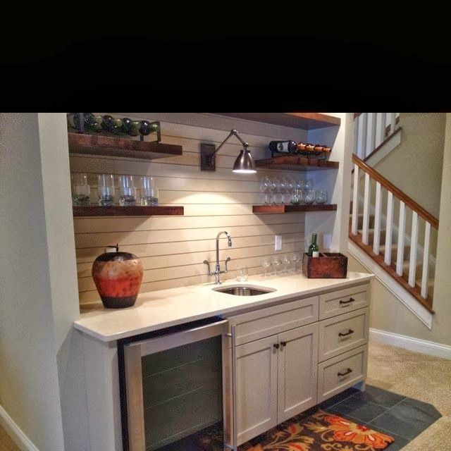 Love the open shelving design in this #home wet bar. Great design!