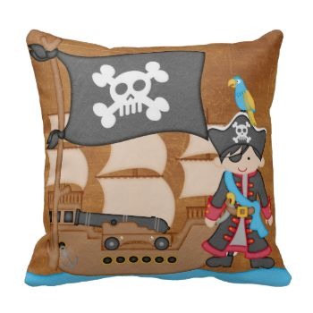 A boy pirate with black hair wears a hat with a parrot sitting on the brim. A pirate ship complete with canon and a skull and crossbones flag on a pillow your little pirate is sure to love! #mojo #peacockcards #kids #childrens #american #mojo #pirate #pirate #ship #ship #skull #and #crossbones #pirate #flag
