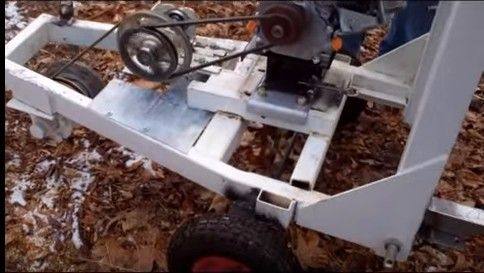 Stump Grinder by Michael Andruch -- Homemade stump grinder constructed from a gasoline engine, tubing, steel plate, wheels, pulleys, bearings, and blades. www.homemadetools...
