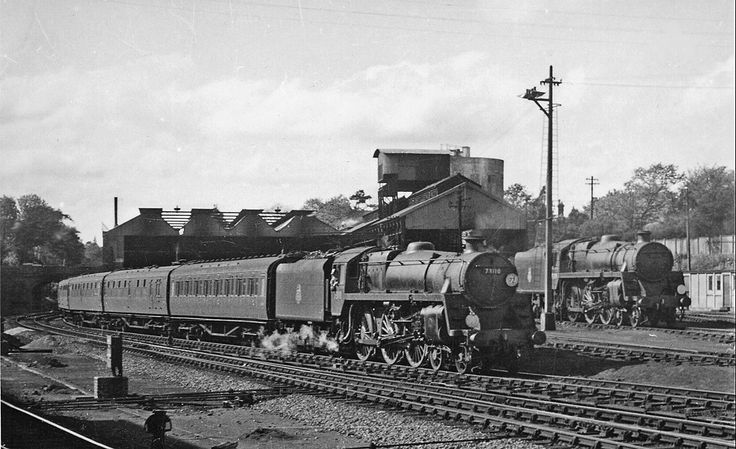 Bournemouth railway station also had a locomotive shed that can be seen behind the arriving train