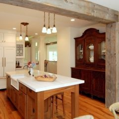 Timber cabinets with white benchtop & incorporating an antique cabinet in to the kitchen is novel