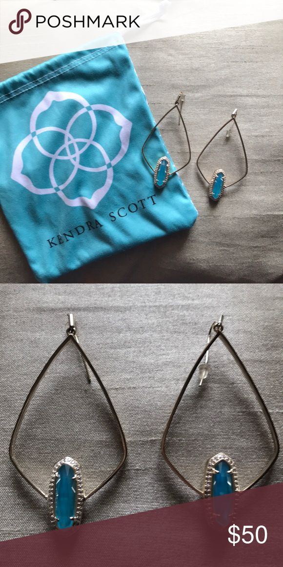 Kendra Scott earnings with teal stone UNIQUE Gold with teal stone 2 inch (approx) drop earrings by Kendra Scott. Worn a handful of times. I have NEVER come across another person wearing these and have been unable to locate their given style name/exact retail price. Kendra Scott Jewelry Earrings