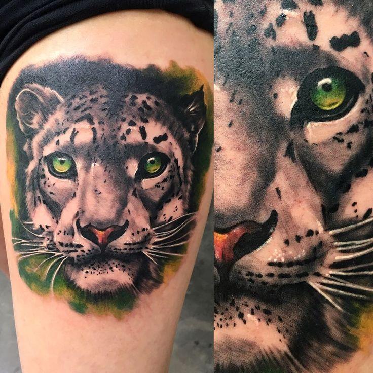 realistic snow leopard tattoo by SKERYONE