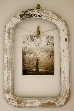 Easy project with an old, dark wood frame (empty), some cream acrylic paint (pat on with wadded-up waxed paper, then use an old clothespin to suspend a vintage photo in the center.  Hang and enjoy!