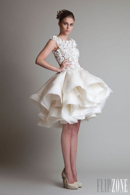 I'm not usually into short wedding dresses, but if I were to go short I would definitely go for this dramatic number!
