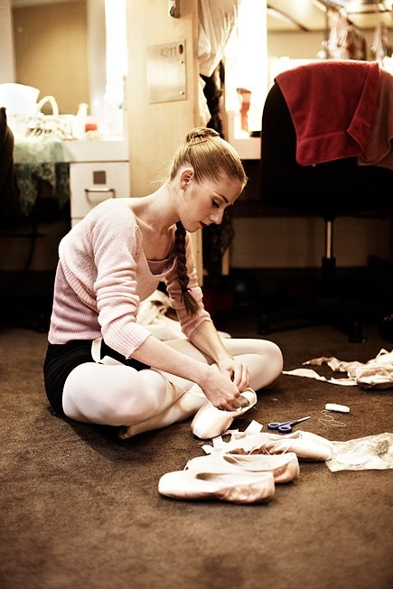 The art of sewing new pointe shoes.