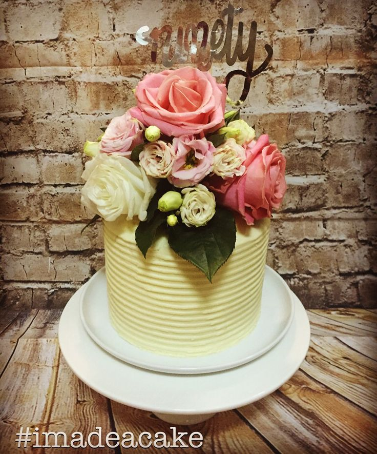 Four layer carrot cake with cream cheese icing and fresh flowers. #imadeacake