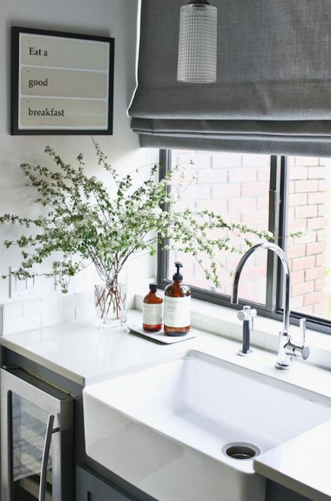Nice sunny and simple kitchen sink area