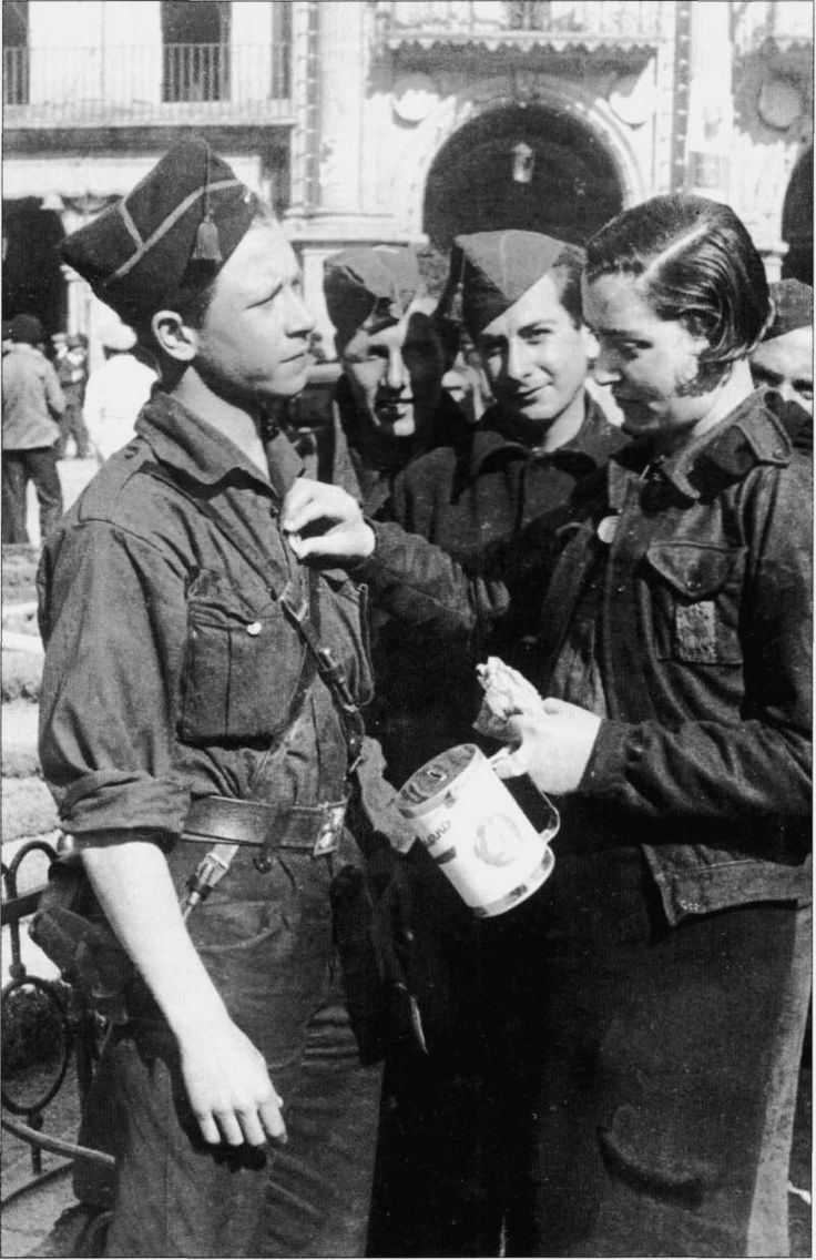 Spanish civil war in september 1936 0a a young woman collecting for the nationalist armies