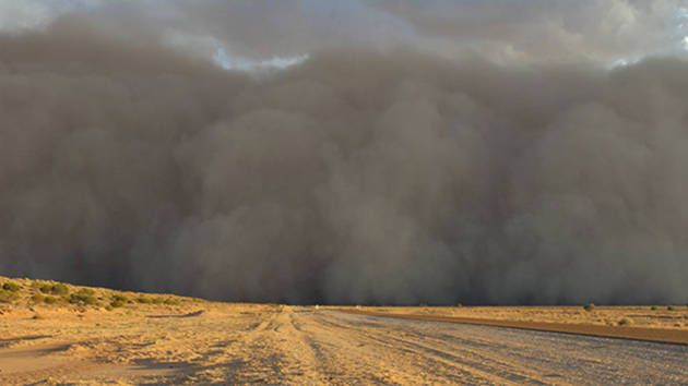 A small town in the Queensland's south-west has been engulfed by a cloud of dust.