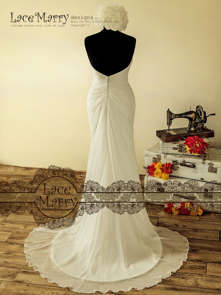 Flowing Chiffon Skirt with asymmetrical folds is finished by Elegant Chapel Train with Wavy Hemming!!!