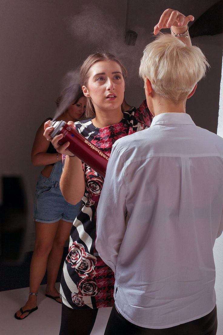 Tayler applying the finishing touches to her model
