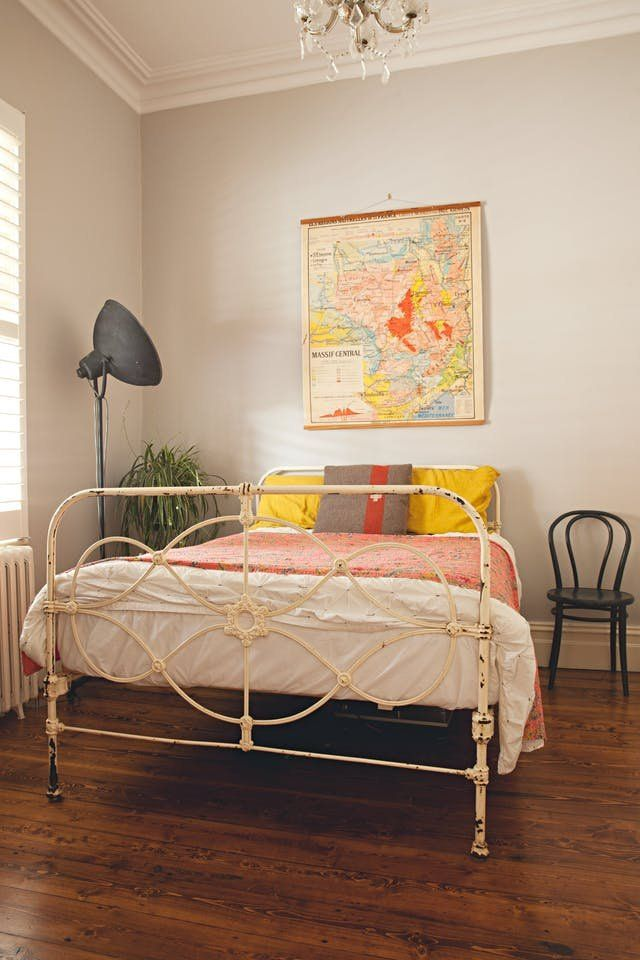 Bedrooms With Properly Hung Art | There are a lot of things to think about when choosing art. From what type of art (photograph, painting etc) to the color, style and pattern. You also have to consider where in the space it's going to go. Not just which room or which wall, but how many inches away from the sofa? How high on the wall? How big compared to the bed? Here is some art inspiration to help you hang yours.