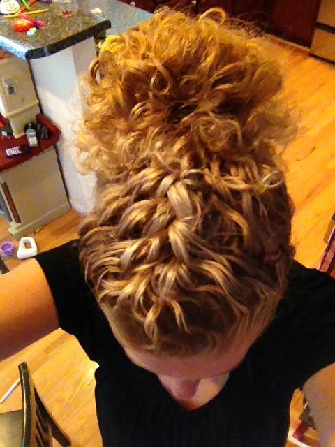 Curly hair braid in front; messy bun behind or reverse and braid up the back