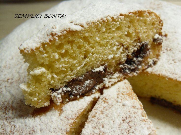La torta con philadelphia e nutella è morbida soffice grazie alla presenza della phiadelphia nell' impasto, nasconde un goloso cuore di nutella . ricetta :