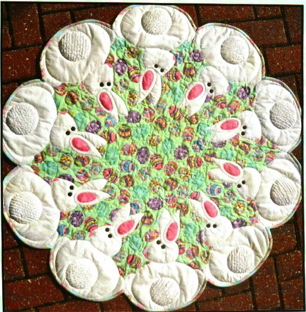 Bunnies All Around Table Mat/Wallhanging Pattern by Quilted Garden at KayeWood.com. Ten sweet bunnies show off their tails which use chenille fabric 'you' make. Stacked applique is completed while quilting to make this a quick project and it is all wrapped up with bias binding. http://www.kayewood.com/item/Bunnies_All_Around_Pattern/3833 $11.00