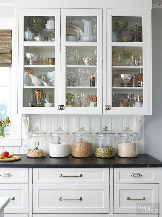 Keep a uniform look on your countertops with clear storage containers. Buy them in bulk online from kitchen supply stores for less. They're good for storing dry cereals, pet foods, and snacks, too. Even apothecary jars with long lost or broken lids can be used to store a countertop collection of rolling pins on end./