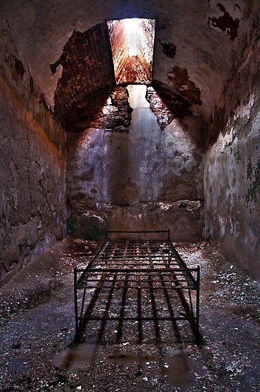 A prison cell at Eastern State Penitentiary Historic Site in Philadelphia, Pennsylvania.