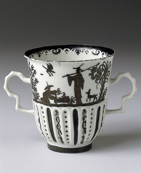 Chocolate Cup  Irminger, J.J. (model); Seuter, Abraham (painting).  Germany, Meissen. Circa 1715-1730 Porcelain; painted in silver. H. 7.7, diam. 7 cm (cup); diam. 14.7 cm (saucer)  The State Hermitage Museum