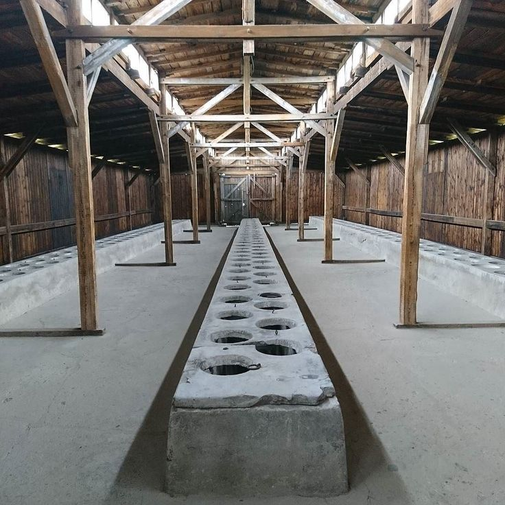 Auschwitz II-Birkenau. Latrine wooden barracks. --- Photo by @kopfsteinpflasterkid --- Original caption: 'Last week I took this picture of the sanitary facilities in Auschwitz-Birkenau also known as camp Auschwitz II. I decided to post a picture that you may not have found until now. To me it represents the humiliation of the prisoners who were deported there: There is no privacy no dignity to be found no matter where you are. In every detail of industrial killing and humilitation you can…