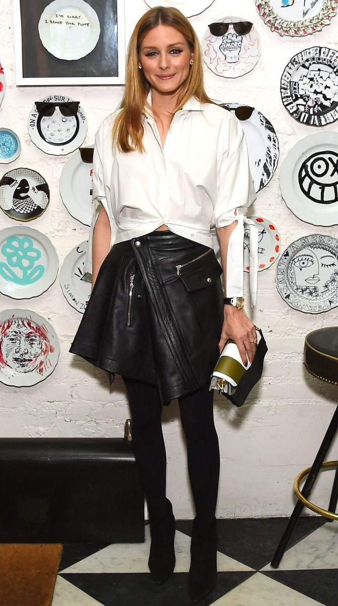 Olivia Palermo in a white top, leather miniskirt, tights and booties