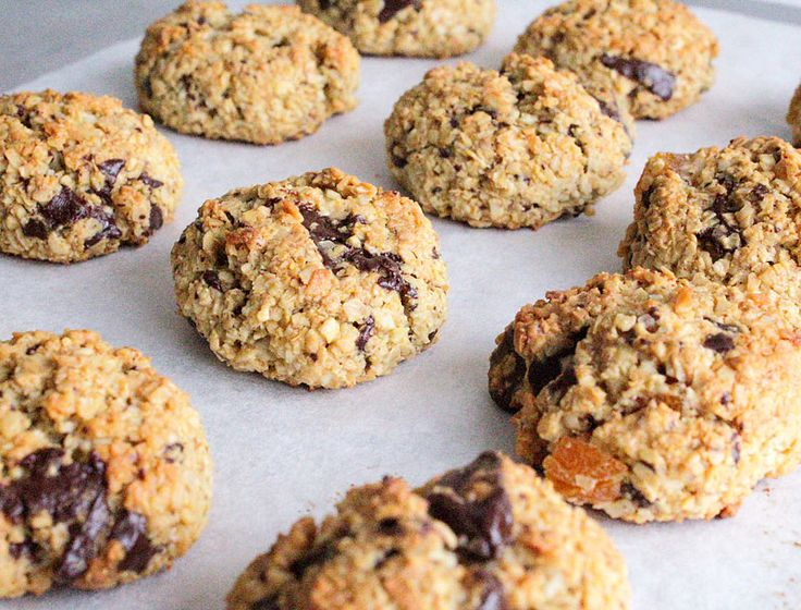 These Oaty Chocolate Chunk Biscuits are a perfect combination of oats, coconut, chocolate and apricots. Perfect for lunchboxes or as an afterschool snack!
