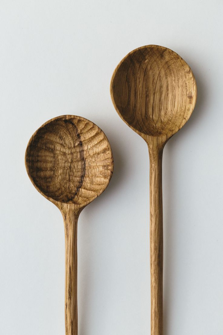 Beautiful hand carved round cooking spoon crafted from Oak sustainably sourced from Epping Forest.