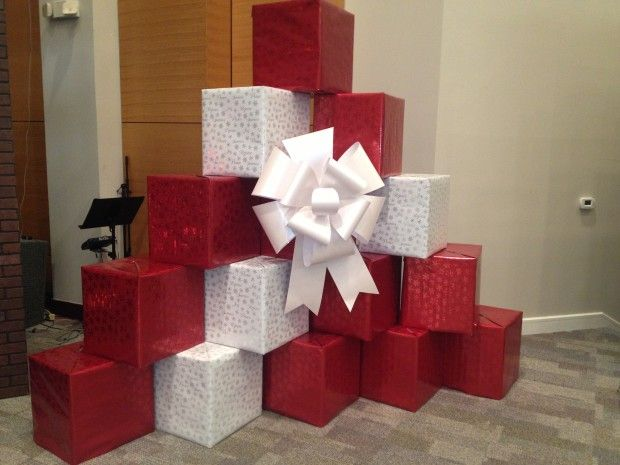 moving boxes, wrapping paper, king size bow, stacked in pyramid