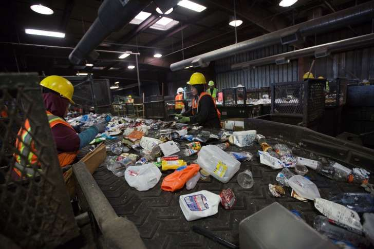 Workers sort paper and plastic waste at Far West Recycling October 30, 2017 in Hillsboro, Oregon. China is sharply restricting imports on recycled materials, and the impact will be felt across the Pacific Northwest. Some of the waste is likely to end up in the regions landfills as China rolls out new rules banning imports of 24 types of recyclables and restricting the amount of contamination in other imported waste materials.