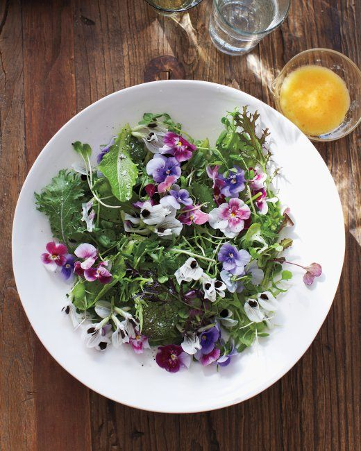 Put fresh pansies on your table and in your belly. Green Salad with Edible Flowers- The dressing is fabulous and the pansies make it oh so pretty.