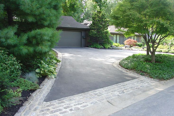 Beautiful driveway and house front. Asphalt driveway with stone edging and driveway apron = functional, cost-effective, and aesthetic. via DiSabatino Landscaping.