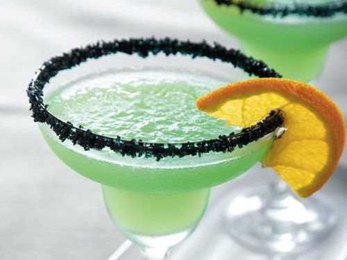 Monster Mash Margaritas Ingredients & Measurements: 1 cup Tequila 1/4 cup Orange Liquor 1/2 cup Lime Juice 1/2 cup Simple Syrup 2 drops green food coloring 2 drops yellow food coloring Ice Cubes Black Sugar Orange Slices Instructions: In blender, place tequila, liquors, lime juice, 1/2 cup simple syrup, the green food color, yellow food color and ice cubes. Cover; blend on high speed until smooth. Dip rims of glasses in simple syrup and then in coarse sugar. Garnish with orange slices.