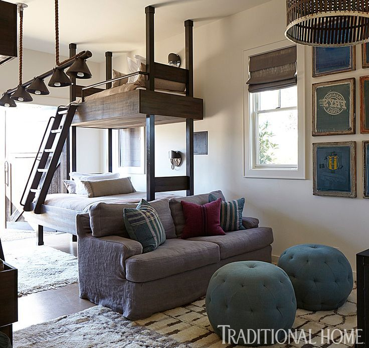 Fun kids' room features wood and metal bunk beds, industrial bunk beds, dressed in natural linen ...
