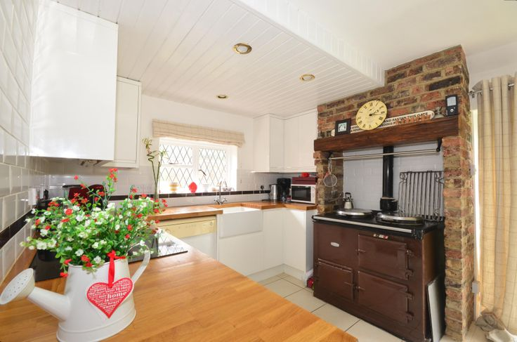 We love the decorations in this kitchen - not to mention the wonderful Aga