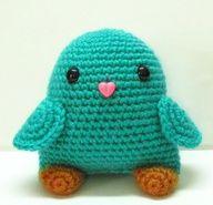 Amigurumi bird. I love the heart button for the beak!