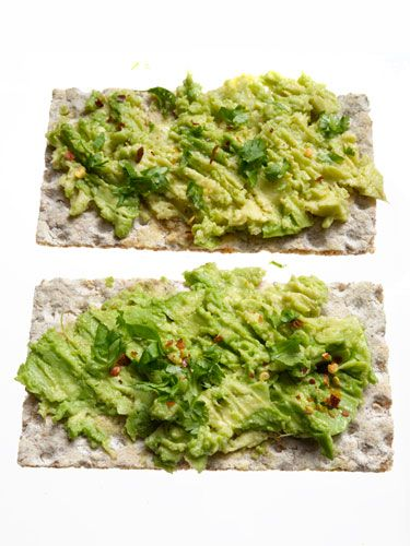 Avocado with Lime on Crackers... low calorie snack.