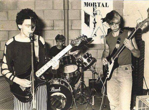 https://flic.kr/p/KtS98S | Mortal Remains, Ommen, the Netherlands 1982 | Hans van Noort, Lude Kraak, Erik Kelder practise behind café de herberg