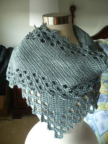 """Start this rectangular scarf in one corner and crochet it on the bias to the opposite corner. The special """"filet lace""""-style edging is crocheted as you go."""