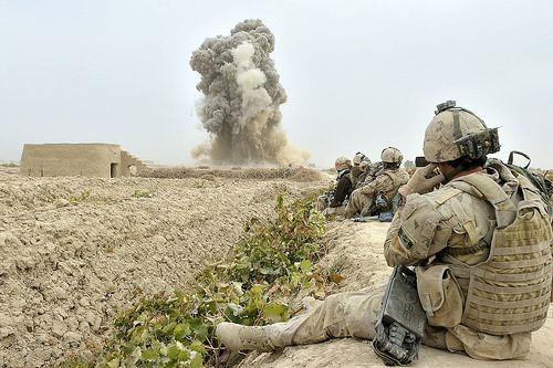 100 Images From Afghanistan - Day 61. Patrol personnel watch from a safe distance as a cratering charge detonates.